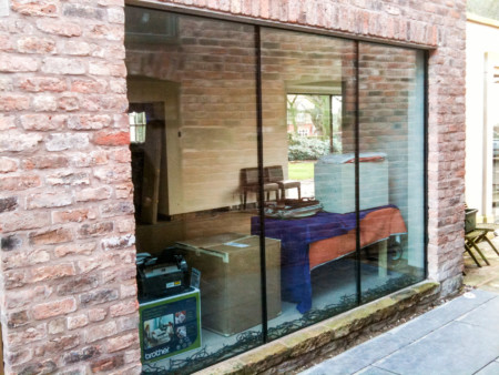 Sky-Frame sliding door system with frameless glass roof lights.