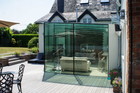 Structural glazing with frameless glass doors.