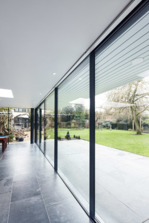 Structural glazing and Sky-frame sliding doors.