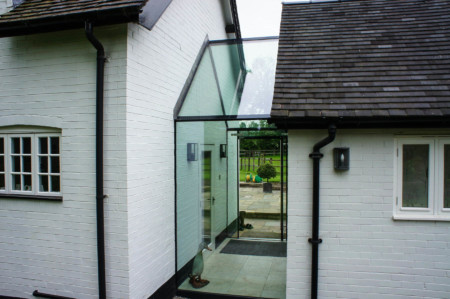 Frameless glass link to main house plus structural glazing and Sky-Frame 2 sliding doors